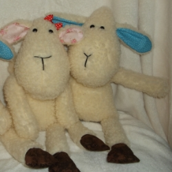 Cuddly sheep blue ones are 16inches high and pink ones are 15inches high. They all have safety eyes and are filled with fire retardant toy stuffing. Suitable for children of any age.Pink ones have a red bow in their hair