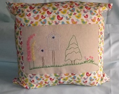 Embroidered Garden and Birdhouse cushion on an even weave cotton with a bird design patterned backing and border. Cushion 18 X 18 inches.