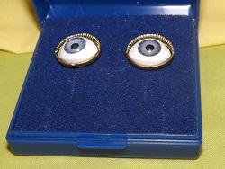 Yellow metal earrings for pierced ears. Blue Eyeballs.