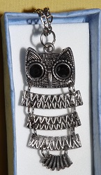 Owl necklace with separate body links,has black eyes unusual design.