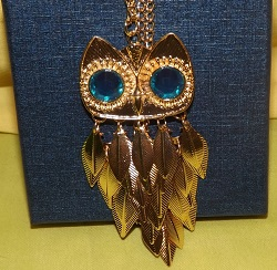 Gold tone Large owl necklace, individual moving feathers, large bright blue sparkly eyes.