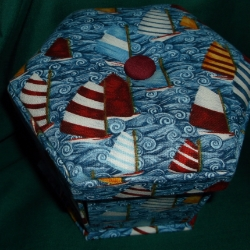Hand crafted sewing box with folding scissors, tape measure, needles, buttons, pins, threads and more. approx 4.5inche x 5.5 inches. Sides fall open to display contents. Pull ribbons gently to reassemble.