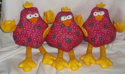 Quirky chickens, most have yellow glittery fabric legs, tails, wings and combs. Stuffed with fire retardant toy stuffing.