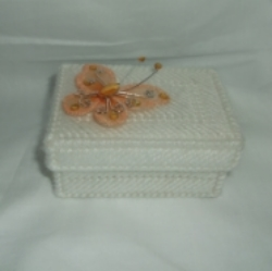 White tapestry covered, plastic canvas trinket box with beautiful large Butterfly. Butterfly is large pale orange and is jeweled. Size 2.25 inches wide x 1.5 inches high x 3.5 inches long. Hand crafted.
