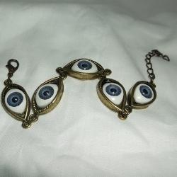 Quirky Gold tone Eyeball Bracelet, blue eyes.