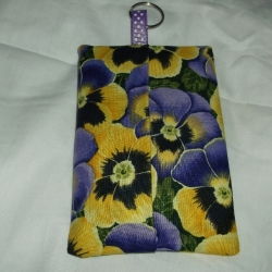 Tissue pouch with packet of pocket tissues and keyring attachment. Various designs available.