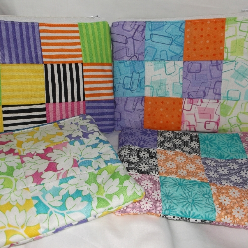 Make-up bag in bright patchwork fabric. 7.5 inches wide by 6 inches high.