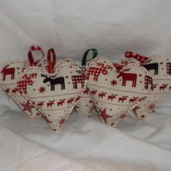 Large heart decoration in reds and cream. Moose and stars Scandinavian design.