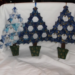 Large fabric origami Christmas tree decoration. Each one is unique. Some have jingle bells and others have bell shaped bells, all beautifully hand crafted.