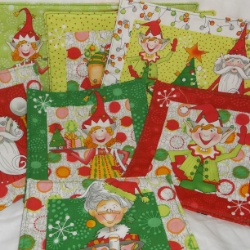 Set of 7 Quirky elf design Christmas mats. 1 large, 2 medium and 4 small in contemporary Christmas colours.