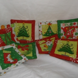 Set of 4 Quirky elf mug rugs in contemporary Christmas colours.