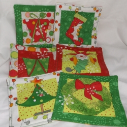 Set of 6 Quirky elf Christmas mug rugs in contemporary Christmas colours. Hand crafted.