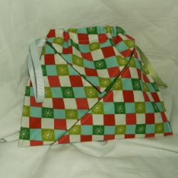 Christmas fabric, drawstring gift bag. Central pouch with a pocket on either side. Approx. 9 x 8 inches.
