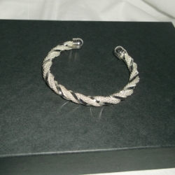Twisted mesh open bangle with plain twist detail. 925 silver.