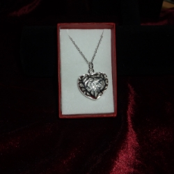 Large filigree heart pendant on a 20inch chain. 925 silver.