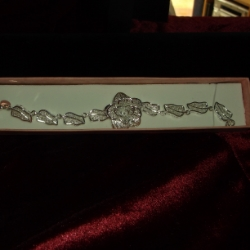 Very pretty filigree bracelet of leaves and a large flower. 8 inches long. 925 silver.