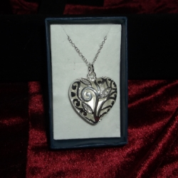 Filigree heart pendant with sparkly detail. Back of heart is plain, it has an 18inch chain. 925 silver.