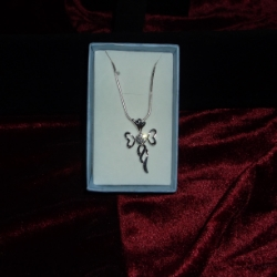 Contemporary cross pendant with a cubic zirconia, on an 18inch fine snake chain.925 silver.
