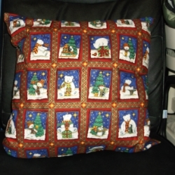 "18"" Christmas cushion with polar bears and penguins with a sumptuous gold print."