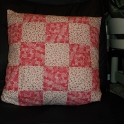 "18"" Patchwork cushion in a pretty pink and white roses design. Would compliment the shabby chic look."
