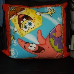 """Sponge Bob Square Pants quilted cushion 20"""". Made from a printed panel with Patrick the starfish. Cushion has a red backing. Suitable for children."""