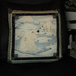 "18"" Quilted polar bear cushion from a panel, which has silver detailing. Cute cartoon type design."