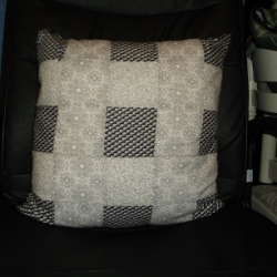 "18"" Black and white patchwork cushion. Would compliment a masculine look room."