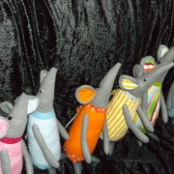 Felt and Fabric Rats with a bow on the tail.