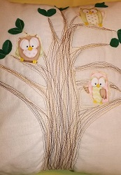 Cute appliqued Owls, in pastel colours on a pale yellow and green backing, has 3D felt leaves.