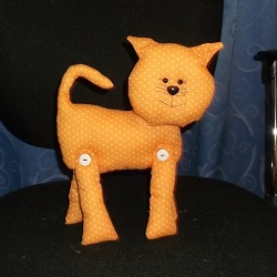 Cat with button legs. Features safety eyes and nose, stuffed with polyester toy filling