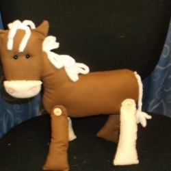 Horse with button legs and chenille mane and tail Features buttons on the muzzle, safety eyes and polyester toy filling.