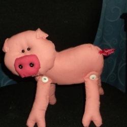 Pig with buttons on snout, cord tail and button legs. Stuffed with polyester toy filling.
