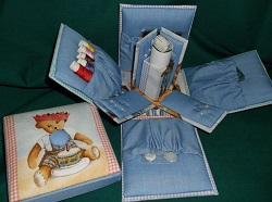 Hand Crafted Sewing Kit with all the basics, including folding scissors, thread, pins, needles, tape measure and more. lift lid box sides open to lay down.